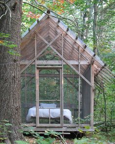 For a slightly more luxurious than usual take on sleeping in the great outdoors, I love the idea of constructing a screened shelter just steps from the backdoor.     You can enjoy the sights and sounds of nature, minus the bugs and tent setup drama.