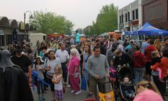 Crowds packed Main Street on Saturday for the opening day of the farmers' market. Photo by Sarina Rhinehart/Ames Tribune  http://amestrib.com/news/farmers-market-kicks-food-truck-showdown