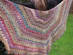 Eva's shawl:  can be made any size; 2 skeins (590 yds) used here; hook size depends on yarn.  Worked in CH, SC, & DC.  Skill level: beginner.  Gorgeous colors used on this one - Noro Silk Garden Sock, colorway 279.  *Free* pattern here http://milobo.files.wordpress.com/2008/10/evas-shawl1.pdf      #crochet #shawl