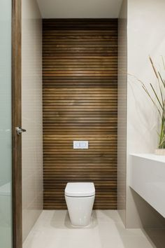 Ensuite - wooden look tiles. Smoky glass entry door.