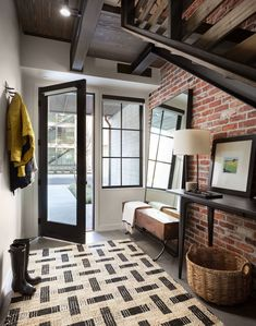 Industrial Entryway Design with Brick Wall and Wood Bench via Dana Webber Design Group Painted Brick Walls, Faux Brick Walls, Exposed Brick Walls, Brick Wall Tv, Entry Way Design, Entrance Design, Loft Furniture, Furniture Design, Interior Styling