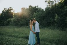 A BLUE FLOWLY DRESS AND A SUNSET MAKE A MAGICAL PICTURE. Photo by: Elizabeth Conley Studios