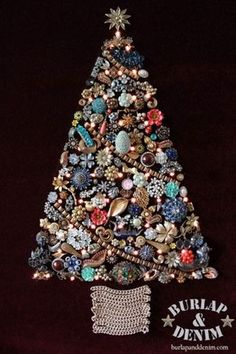 Make a vintage jewelry Christmas Tree with lights. This one used my grandmother's costume jewelry on burgundy mohair with lights.