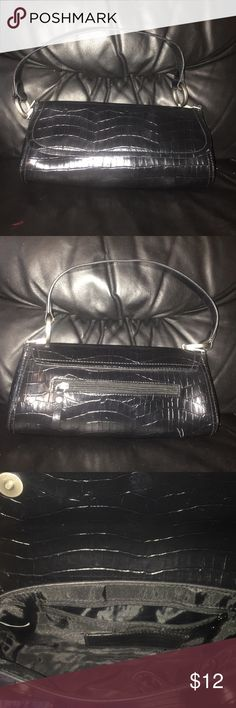 Bueno Mini  Bag Very nice black Bueno clutch purse in excellent condition crocodile skin design! Two button Closure  one exterior pocket and one interior pocket with a pen holder! Bueno Bags Mini Bags
