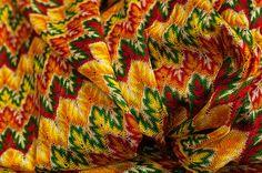 FABRIC : PRINTED SPENDEX NET. #bright #hues #vibrant #colors #yellow #sunnyorange #ochre #red #green #prints #textile #spendix #fabric