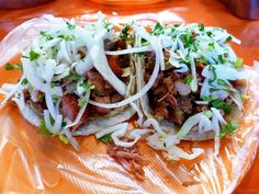 """The Best Carnitas Tacos at Xochimilco Market - Slow roasted pork """"carnitas"""" covered in chopped onion and cilantro www.hungryandconfused.com/2013/05/the-best-carnitas-tacos-at-xochimilco.html #food #travel #foodtravel"""