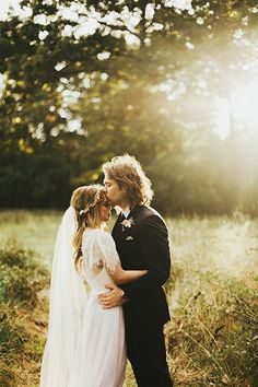 Natural, golden sunlights casts an ethereal glow on this bohemian couple.
