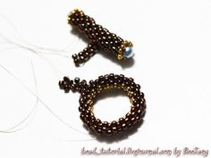 Tutorial : Bar and Ring Toggle Level : Beginner Technique : Peyote Equipment: - Seed beads 11/0 (or Delica beads 11/0) - Seed beads 15/0 - Pearl 4 mm. (or crystal 4 mm.) - Nymo or your favorite thread - Needle My bar and ring toggle are very similar to Laura McCabe's version. Bar 1. On the…