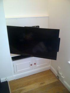 TV on bracket in alcove