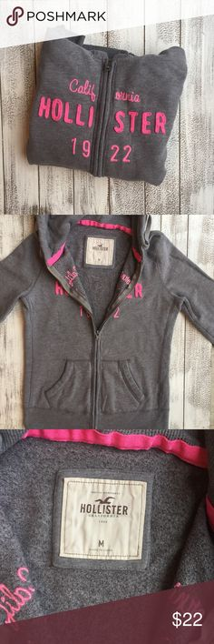 ONE HOUR 🎉HOLLISTER ZIP UP SWEATER WITH HOODIE Hollister zip up sweater with hoodie, very good condition. Medium Size. Gray with pink. Hollister Sweaters