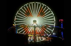Pacific Park's Ferris wheel on the Santa Monica Pier will set the spooky southern California scene tonight, Oct. 31 with a variety of seasonal colors featuring orange, yellow, and white, and extraordinary patterns that include a 90-feet tall smiling pumpkin.