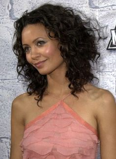 Naturally Curly Haircuts. Thandie Newton. Long Dark Brown Extremely Curly Hair Style Picture.
