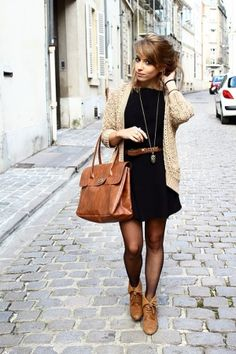 Black skater dress, oatmeal colored cardigan, skinny brown belt, sheer black tights and brown boots