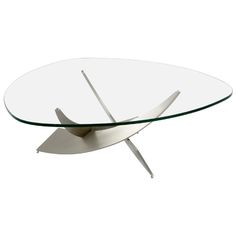 Reef Cocktail Table from Copenhagenliving.com  Not stated whether tempered.  Assume not.