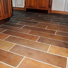 Showroom Kitchen Remodel with Marble Field Tile and Porcelain Plank Floor