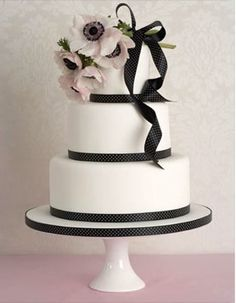 Cake idea.  But, with satin taupe ribbon and amnesia roses for the flowers.