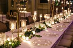 How to transform an open ballroom with stunning decor   Sapphire Events   Greer G Photography   Board of Trade   White and Gold Wedding   Winter Wedding Inspiration   White and Green Wedding   Ballroom wedding   long table floral garland