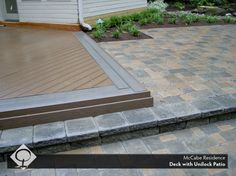 Great example of how to segue from one type of material to another. Love the graceful repetition of the stone colors in the deck. Design by The Cornerstone Landscape Group.