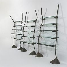 RON ARAD    shelves from Bazaar/Jean-Paul Gaultier    One Off  United Kingdom, c. 1983  welded and fastened steel, glass  175 w x 16 d x 90 h inches