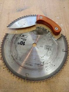 Knife made from saw blade with Mahogany handle