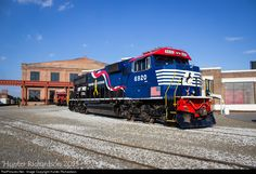 """Setting adjacent to the Bob Julian Roundhouse in Spencer, North Carolina, the Norfolk Southern """"Honoring Our Veterans"""" SD60E awaits the following day's National Train Day Activities at the North Carolina Transportation Museum."""
