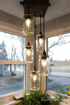 This mason jar light fixture is the perfect addition to any rustic, country home!