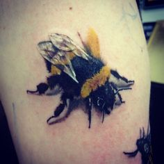 Highly detailed bee tattoo