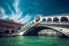 The Rialto Bridge is one of the four bridges spanning the Grand Canal in Venice, Italy. It is the oldest bridge across the canal, and was the dividing line for the districts of San Marco and San Polo.