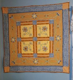 Made from fabric from my Magic Needle quilt group. Hand pieced and quilted by Barbara E Brennan