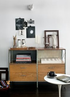 A chest of drawers from Modernica is filled with flea-market finds. The Sasaki cup sitting on the Saarinen table nearby was designed by Massimo Vignelli. (Photo: Bruce Buck for The New York Times)