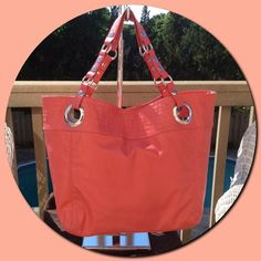 """Steven by Steve MaddenCandy Coated Lizard Tote Steven by Steve Madden Candy Coated Lizard Embossed Tote Salmon Color Oversized grommets anchor hardware-detailed handle straps, topping a voluminous tote finished with a high shine. Magnetic-snap closure. Interior expansion belt with snap closure. Interior zip, wall and cell phone pockets. Polyurethane. Signature Lining. Measurements: 13"""" X 13 1/2"""" X 6 1/2"""". Like new condition.Sold out on-line. Steven by Steve Madden Bags Totes"""