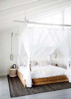 Timber panelling transforms the bed, bought years ago in Bali, that is the central focus of the main bedroom | Home Beautiful Magazine Australia