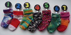 Ravelry: Advent Baby Socks pattern by Olivia Rainsford.. Free pattern!