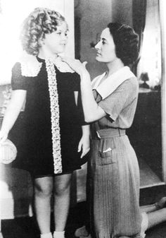 Shirley Temple with her personal dress-maker Elise Deal, 1936.
