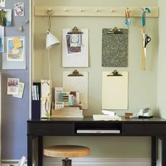 The best way to create extra storage in your home office? Think vertically. Here, a peg rail corrals supplies and a hanging task lamp, while wall-mounted clipboards sit ready to organize incoming papers—one each for bills, unanswered mail, messages, and magazine tear sheets. Next to the desk, an idea-file board, created by affixing ½-inch-thick cork to the wall and covering it in felt, makes it easy to spot inspiration for a future remodel.