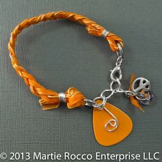 Orange braided Guitar Pick bracelet music and peace charm. GPB01 | MartieRocco - Jewelry on ArtFire