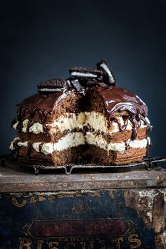 Cookies and cream cake. Cookies and cream layer cake with white chocolate filling rich chocolate glaze and chopped Oreos. Chocolate Filling, Chocolate Desserts, Chocolate Glaze, White Chocolate, Chocolate Cookies, Oreo Desserts, Chocolate Frosting, Baking Recipes, Cake Recipes