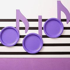 <p>Raising+a+rocker?+Let+him+get+his+groove+on+in+a+music-theme+party+that's+worth+singing+about.</p> ++++++++++++++++<p>Use+black+tape+on+a+white+tablecloth+to+create+a+music+staff.+Attach+paper+shapes+to+plates+to+resemble+notes.</p> ++++++++++++++++<p><strong>What+you'll+need:</strong>+7+inch+paper+plates,+craft+paper,+tape,+pencil,+scissors</p> ++++++++++++++++<p><strong>Make+it:</strong>+Use+template+to+cut+out+music+note+shapes+from+craft+paper.+Attach+to+back+of+plates+with+tape.</p>