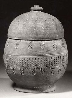 Covered Urn Period: Unified Silla dynasty (668–935) Date: 8th–9th century Culture: Korea Medium: Stoneware with stamped and incised decoration Dimensions: H. 9 in (22.9 cm) Classification: Ceramics Credit Line: Purchase, Lila Acheson Wallace Gift, 1997 Accession Number: 1997.34.15a, b