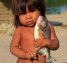 Brazil... the way she hold the fish, it seems like she was holding her favourite toy :)