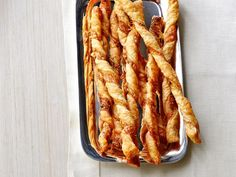 Cheese Straws recipe from Ina Garten via Food Network. Everyone loved these, A. Holiday Appetizers, Appetizer Recipes, Dinner Recipes, Elegant Appetizers, Cheese Appetizers, Quick Recipes, Cocktail Recipes, Valentine's Day Quotes, Food Network Recipes
