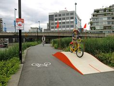 Canadian designer Greg Papove brought Whoopdeedoo installations to a Vancouver bike path. The project interrupts the typical commute of many cyclists and celebrates biking as a fun and spontaneous means of transportation.