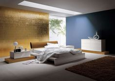 Blu e oro - Abbinare i colori delle pareti per una camera da letto in stile moderno.