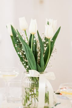 Wedding flowers table decorations with white tulips Tulip Wedding, Wedding Table Flowers, Wedding Centerpieces, Dream Wedding, Wedding Decorations, Table Decorations, White Tulips, Destination Wedding Photographer, Travel Around The World