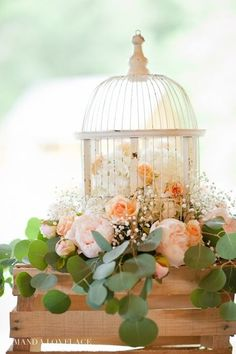 Beautiful peachy floral design wedding centerpiece for the reception.  MarliPaige Floral Designs Amanda Lovelace Photography