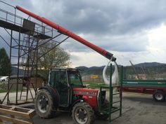 A tractor rigged with hop twining equipment.  Picture taken in May 2014 during a trip by 47Hops to the region.
