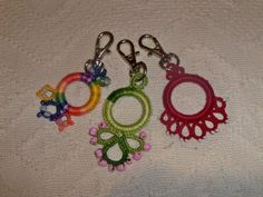 Tatted zip pullers.  So bright and colorful! Neat use of tatting around cabone rings.