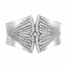 White Gold and Diamond Cuff Bangle Bracelet   18 kt., 223 round diamonds ap. 4.00 cts., French assay mark & maker's mark partially obscured, ap. 61.3 dwt. Inner cir. 6 7/8 inches. Art Deco or Art Deco style.