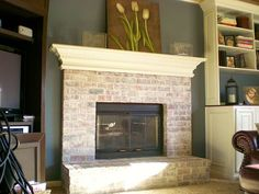 Like this look! Have to do this to our brick fireplace. Whitewash brick fireplace