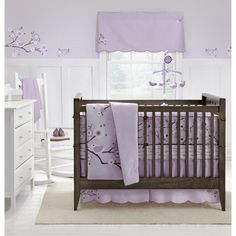 Love a purple and black nursery.  This bedding is so cute!